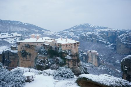 Meteora Monasteries covered by snow in Winter