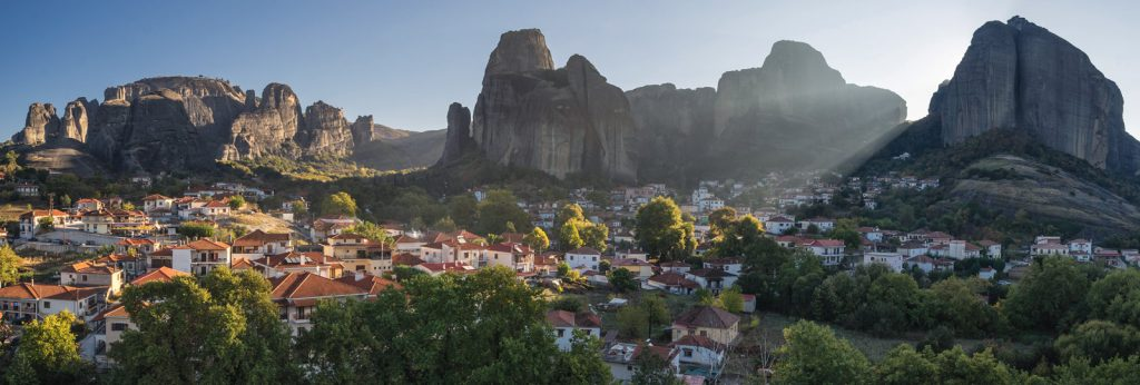 The Sunrays illuminate Meteora rocks and the Kastraki of Village