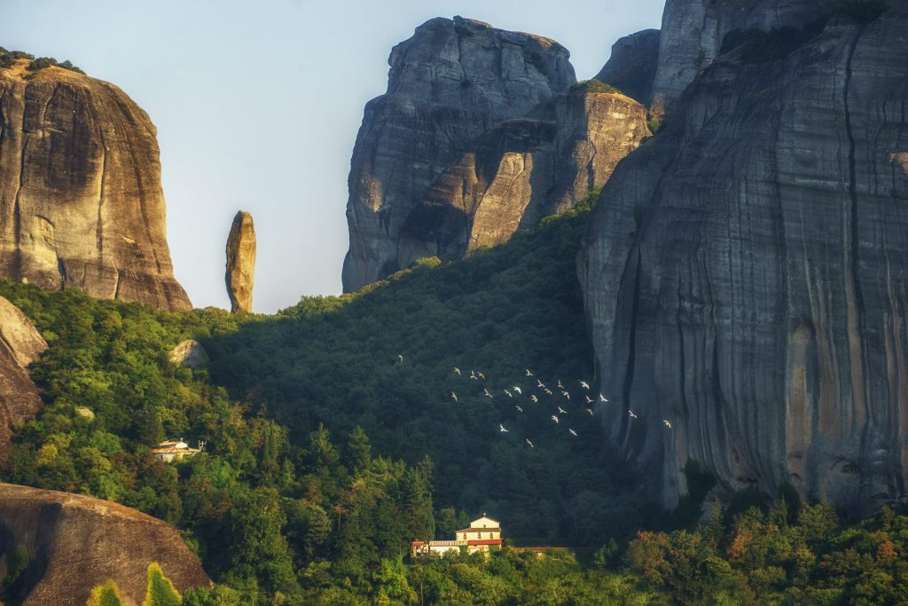 The golden light illuminate the Meteora rocks and the Kastraki of Village