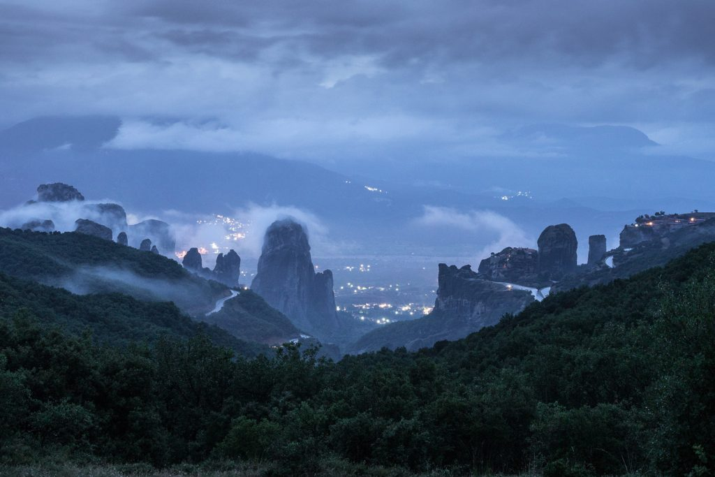 Meteora Monasteries in the dusk and covered by fog