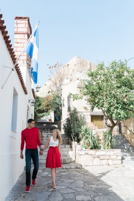 A couple walk in Athens streets