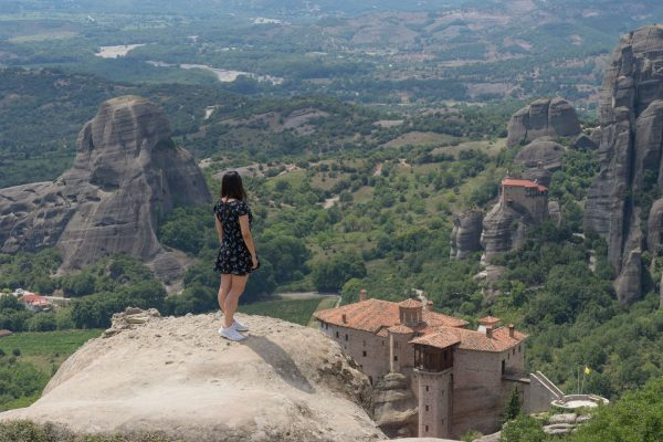 Traveler girl photo shooting in Meteora backdrop