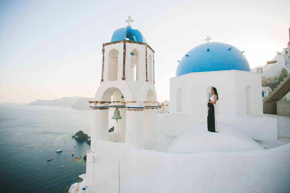 Single girl during her photoshoot on Santorini island