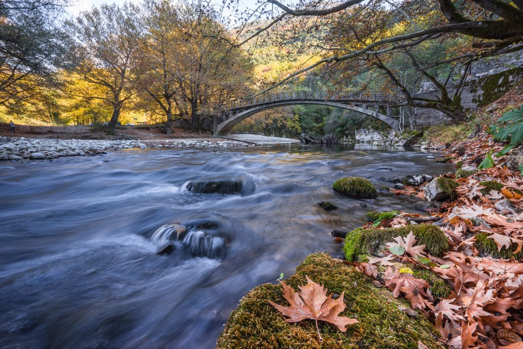 The river of Voidomatis in Epirus and Zagori flow under the bridge in Autumn