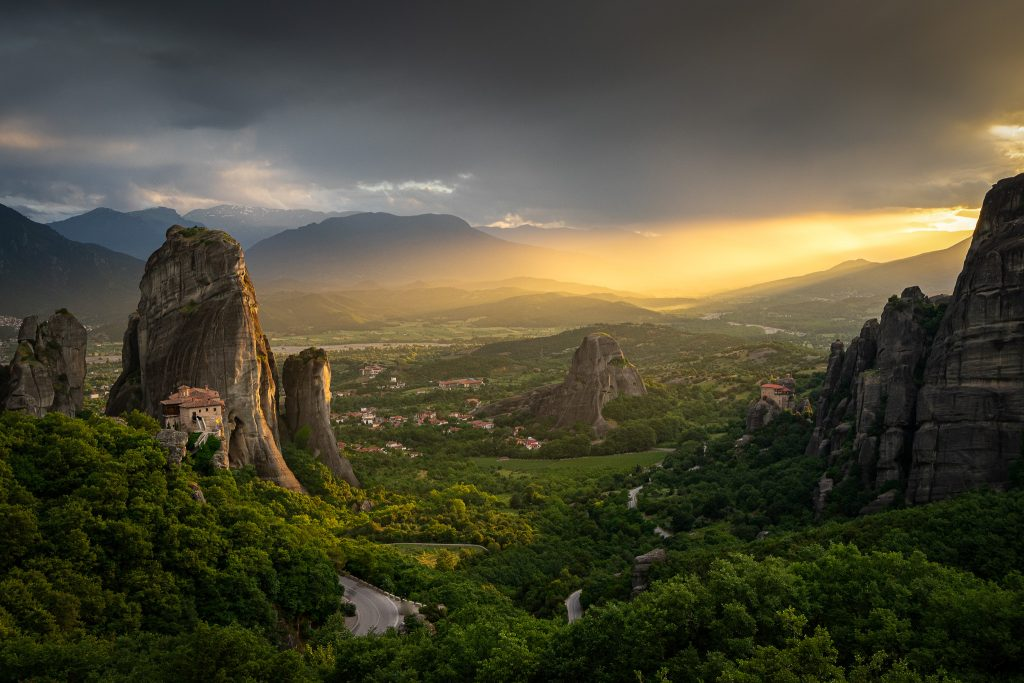 Dimming light on the Monastery of Rousanou , when the sun sets down on Meteora