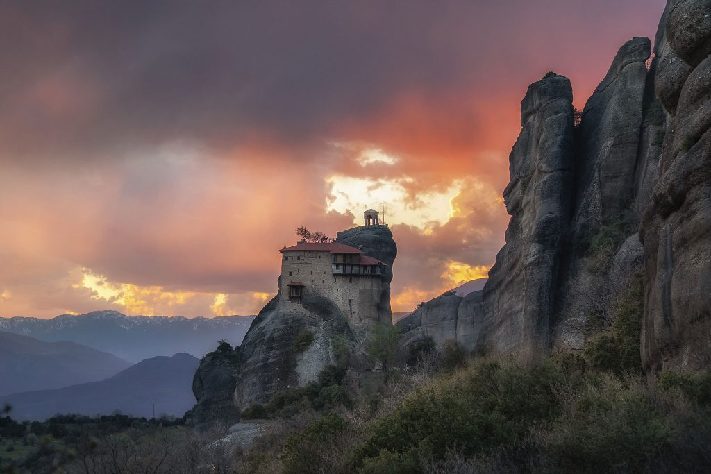 Saint Nikolaos of Anapafsas. The Monastery of Meteora during the sunset